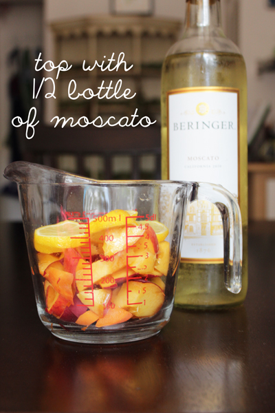 Top the fruit in the 2-cup sized Pyrex cup with half a bottle of moscato.