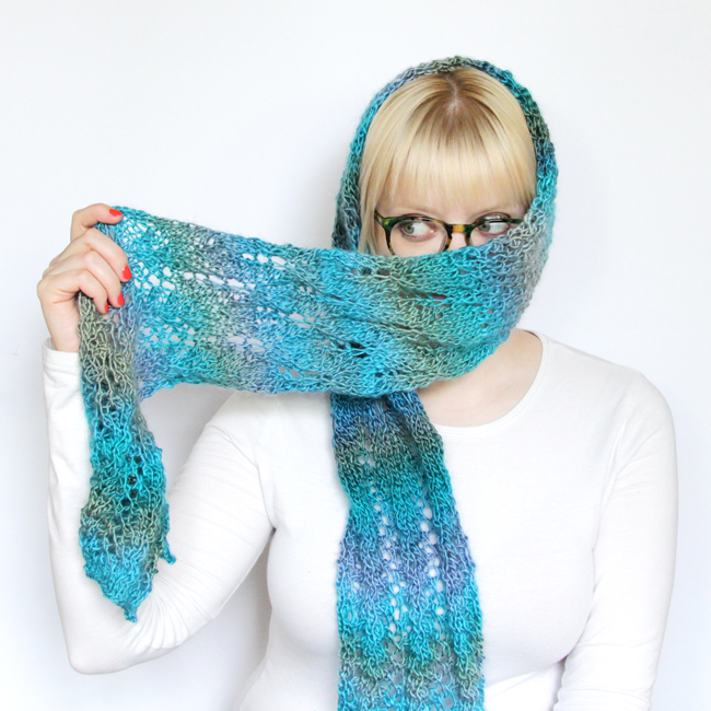 Heidi Gustad modeling her Spring Meadow Scarf knitting design.