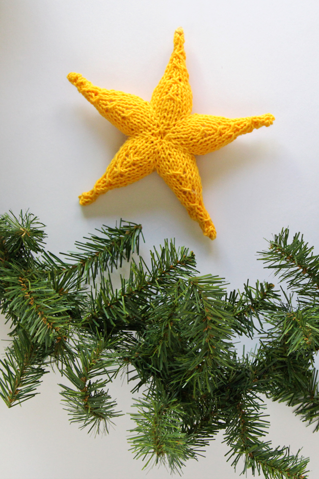 Knit Star Ornament - Click through for a free knitting pattern for this cute star ornament, which also makes a great tree star, gift topper or baby toy!