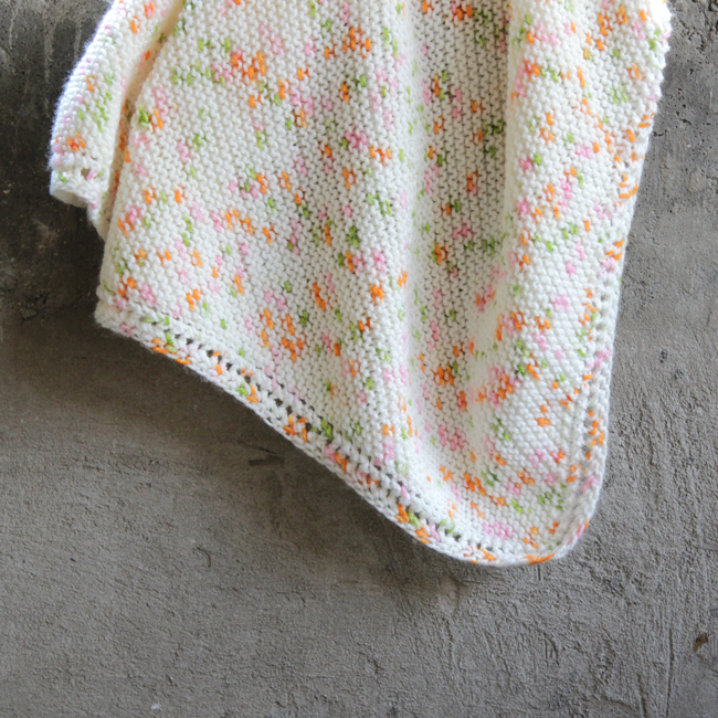 Check out the oh-so-sweet Peas & Carrots Baby Blanket! Get the free knitting pattern for this cute, beginner-friendly baby blanket. A total hit at baby showers!