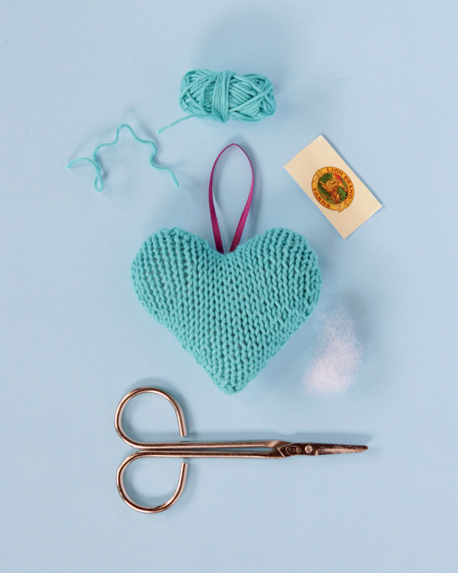 Add a little love to your Christmas tree with a free pattern for this knit heart ornament.