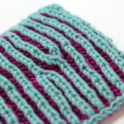 Learn how to increase and decrease stitches in brioche knitting with this easy video tutorial featuring Heidi Gustad from the Hands Occupied blog.