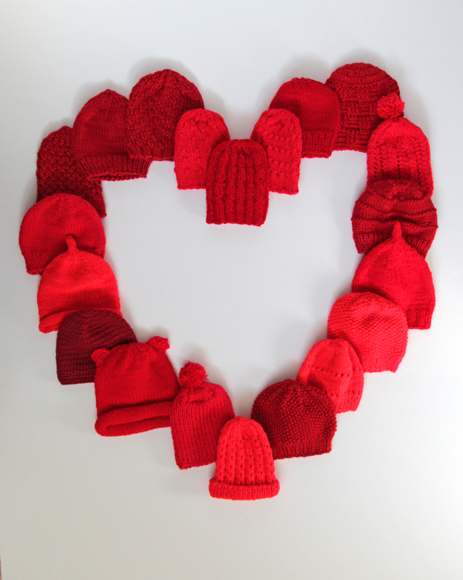 Little Hats Big Hearts pairs newborns with red hats and life saving information every year during American Heart Month. Click through for free patterns and donation information.