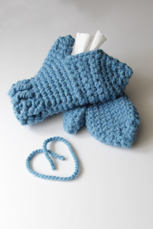 With these mittens, you can keep your hands cozy while keeping Kleenex tissues close at hand! Simply make one traditional mitten, then crochet its mate with an opening to fit a Kleenex Go Pack on top of your hand. These chunky mittens can fit either hand, depending on where its most convenient for you to keep your tissues during sniff season.
