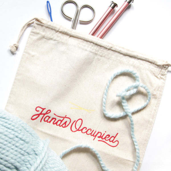 Hands Occupied Learn to Knit kits come in hand-printed, drawstring bags filled with everything you need to knit your first project from scratch!