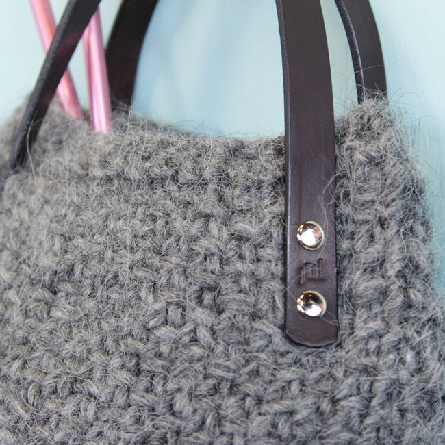 The Lopi Tote makes use of bulky yarn and elegant, screw-in handles to create a deep bag with a wide base that knits up quick. Get your hands on this free pattern, designed with knitters in mind. The Lopi Tote is perfect for carrying your next knitting project on the go!