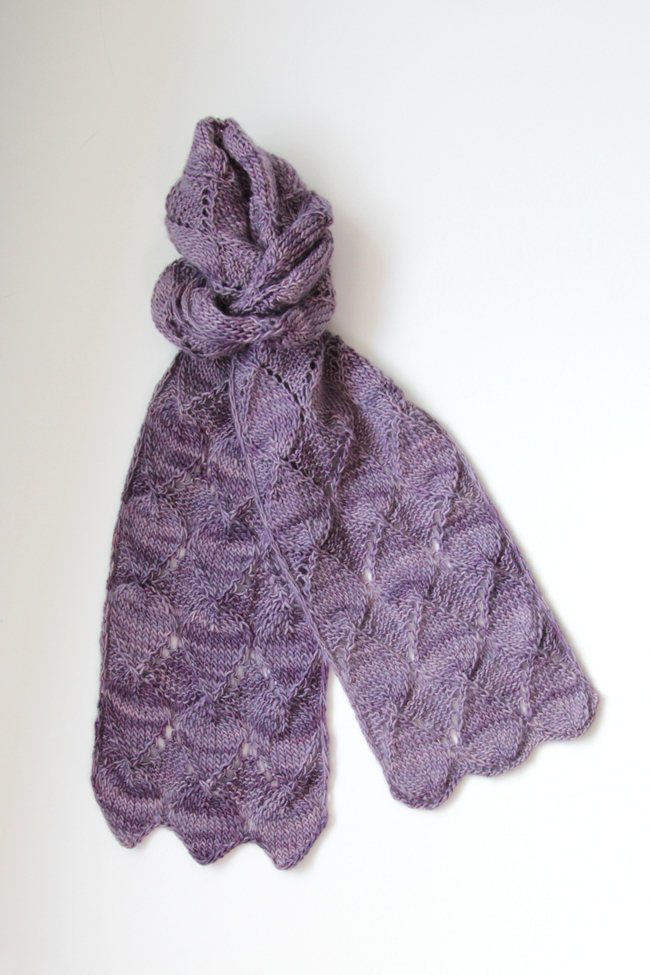 Get your hands on the Ruby Stole knitting pattern by Heidi Gustad. Featuring short rows, easy lace and tons of gorgeous texture, the Ruby Stole is a fun, fast single skein knitting pattern. Find it on Ravelry or in the Hands Occupied Pattern Shop.