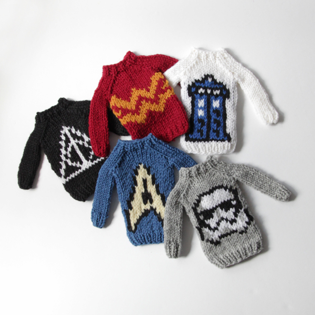 The Mini Fandom Sweaters Collection by Heidi Gustad, designed as part of Fandom Fibers' inaugural collection and available exclusively in kits at C2E2 2018. Available as PDFs beginning April 9.